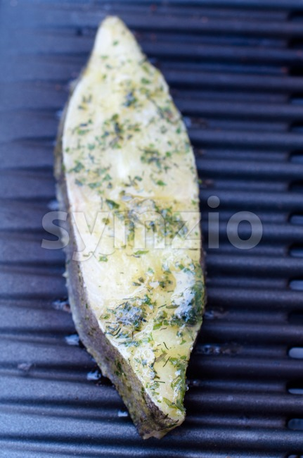 Halibut fillet on BBQ Stock Photo