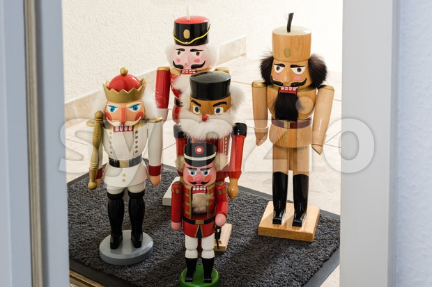 Christmas is close - Army of traditional figurines Christmas nutcracker waiting at the entrance door of a flat