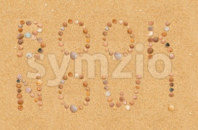 Book now wording on the beach Stock Photo