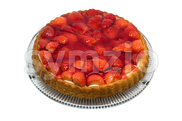 Tart with cream and fresh strawberries on a glass plate on white background