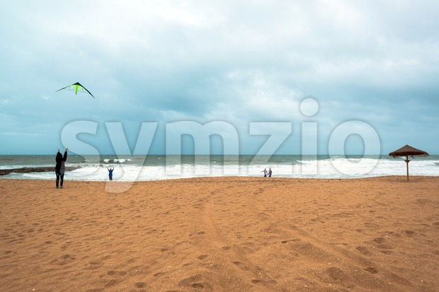 Happy dad and daughter flying kite together Stock Photo