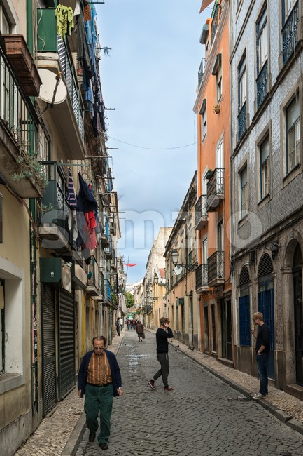 Lisbon, Portugal - October 19, 2015: Typical old buildings in the centre of Lisbon (Portugal) with ceramic tiles (azulejos), people ...