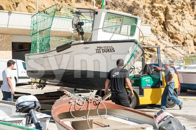Old fisherboat is lifted in a shipyard Stock Photo