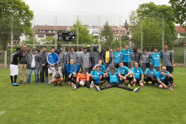 Scharnhausen, Germany - May 14, 2016: Happy group photo after the team of TSV Scharnhausen was playing a friendly match ...