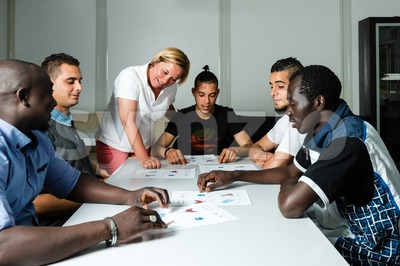 Language training for refugees in a German camp Stock Photo