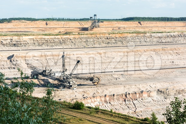 Bucket-wheel excavator digging lignite (brown-coal) Stock Photo