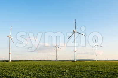 Wind turbines in front of a coal-fired plant Stock Photo