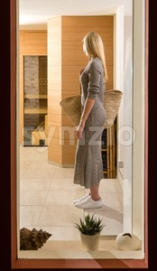 Gorgeous woman entering spa center Stock Photo