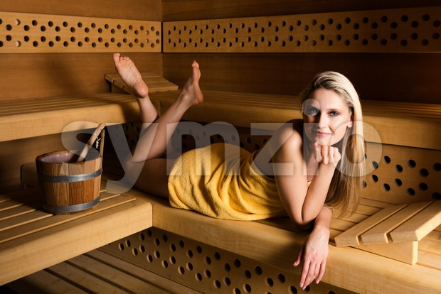 Gorgeous woman relaxing in sauna Stock Photo