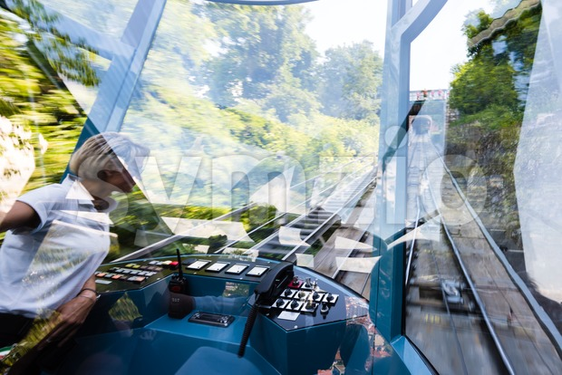 Reflections in the funicular train while climbing to Schlossberg in Graz, Austria. Stock Photo