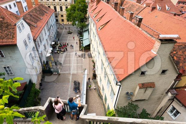 Couple making photos of the Schlossbergplatz, castle hill square, in Graz , Austria Stock Photo