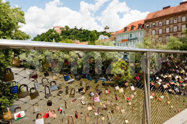 View over love lockers to the old clock tower on Schlossberg, castle hill, in Graz, Austria Stock Photo