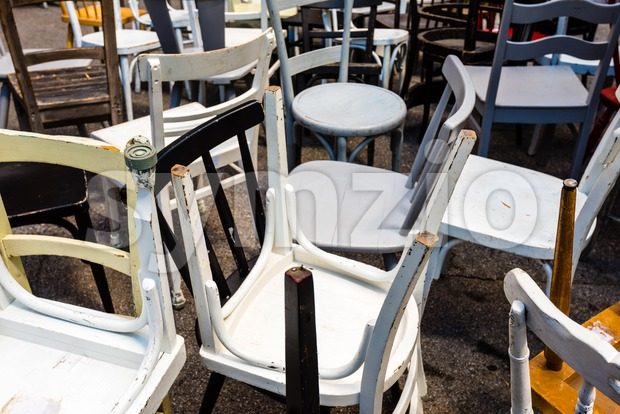Collection of different used old chairs Stock Photo