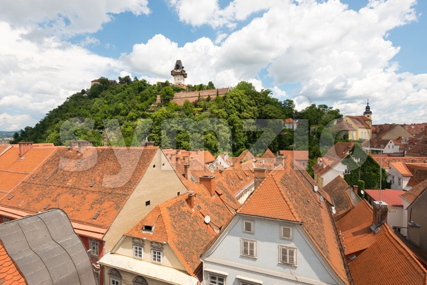 Schlossberg, castle hill, and its clocktower in Graz, the second-largest city in Austria and capital of fthe ederal state of ...