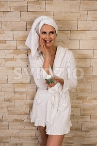 Gorgeous woman having fun with cream jar Stock Photo