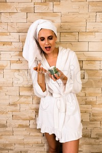 Gorgeous woman using a cream jar Stock Photo