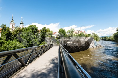 Entering the artificial Mur Island in Graz, Austria Stock Photo