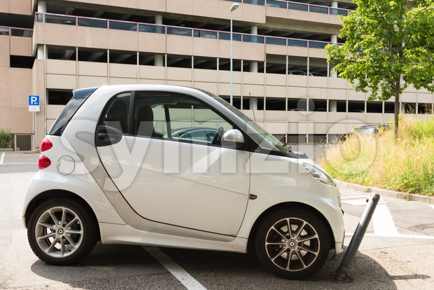 Stuttgart, Germany - June 25, 2016: Very bad parked small Smart car, hitting a metal blocker while parking illegally in ...