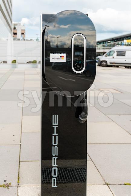 Stuttgart, Germany - June 25, 2016: Porsche charging station for e-cars at the airport in Stuttgart, Germany. Since Stuttgart is ...