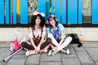 Cosplayers resting during Comic Con Germany in Stuttgart Stock Photo