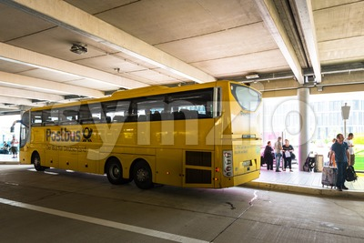 A long distance bus by Deutsche Post in the new Stuttgart Central Bus Station Stock Photo