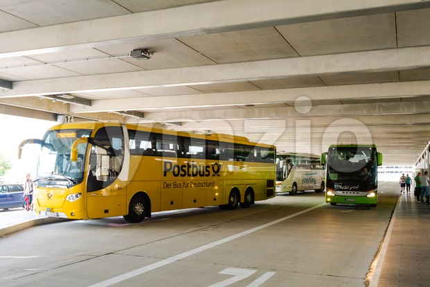 Two long distance busses in the new Stuttgart Central Bus Station Stock Photo