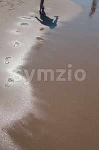 Footsteps on the beach Stock Photo