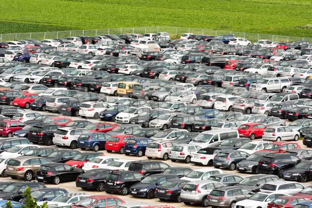 Stuttgart, Germany - June 25, 2016: Hundreds of cars parked in a large parking lot at the airport in Stuttgart, ...