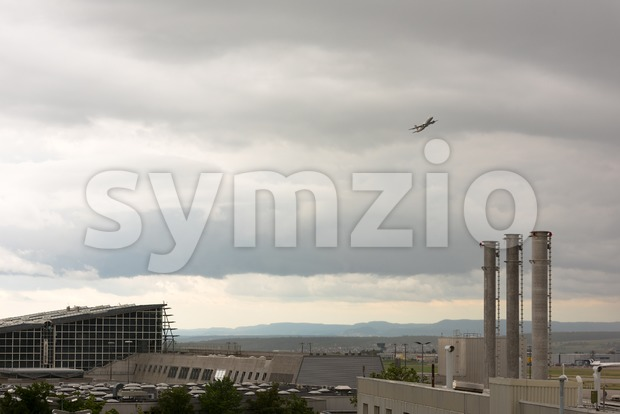Airplane leaving Stuttgart airport Stock Photo