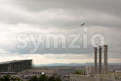 Airplane leaving Stuttgart airport Stock Photo