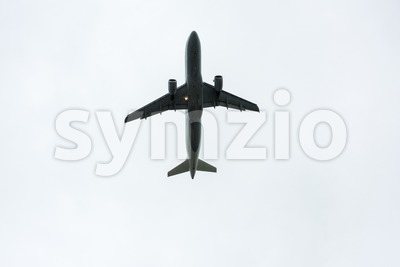 Airplane taking off during rain Stock Photo