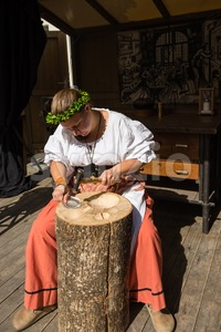 Female silversmith at historic workshop Stock Photo