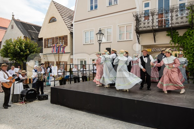 Friedberg, Germany - July 09, 2016: Men and Women are dancing dressed in traditional costumes of the eighteenth century on ...