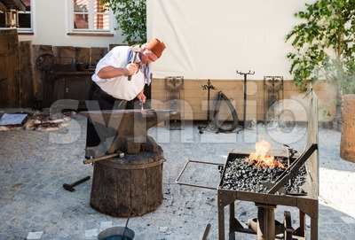 Historic Blacksmith At Work Stock Photo
