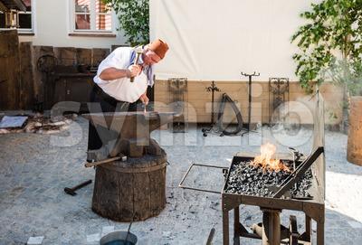 Historic Blacksmith At Work Stock Photo