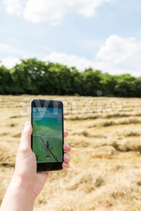 Hand holding smartphone with Pokemon Go app Stock Photo
