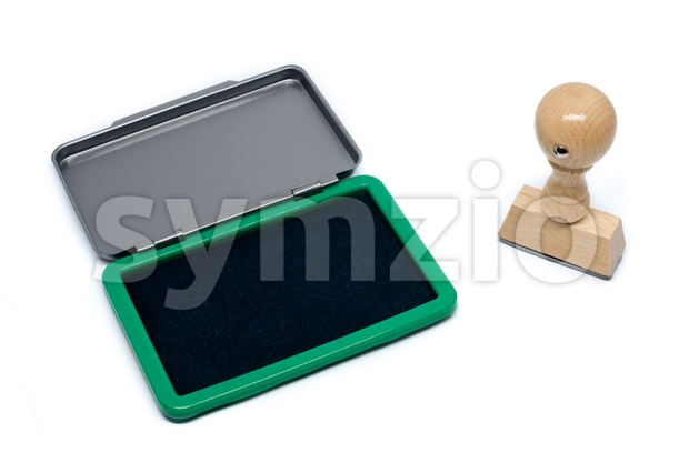 Rubber stamp with green stamp pad on a white background