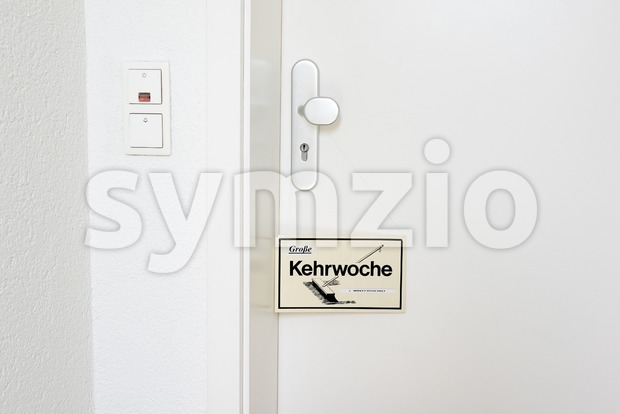 Entrance door with applied reminer of Kehrwoche: The Swabian or Wuerttembergische Kehrwoche, the rotation of cleaning duties,  began at ...