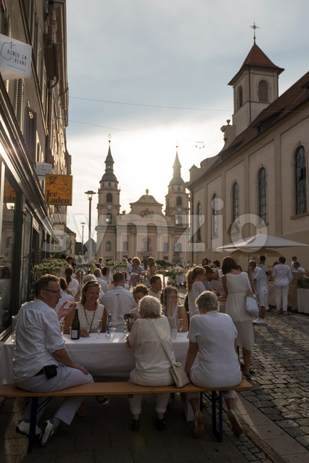 Ludwigsburg, Germany - July 30, 2016: People are enjoying le diner on blanc, the white dinner, where all guests are ...