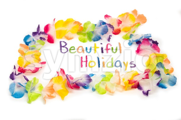 Colorful Hawaiian Flower Necklace with text Beautiful Holidays Stock Photo