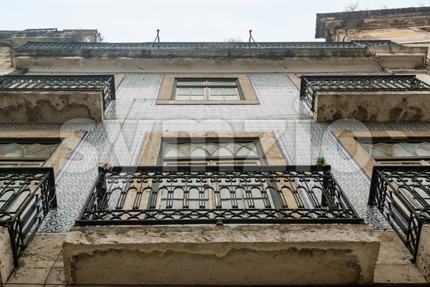 Lisbon house facade with balconies and tiles Stock Photo