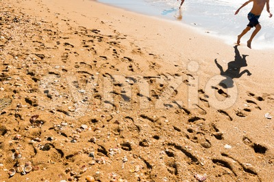 Two happy kids jumping on the beach Stock Photo