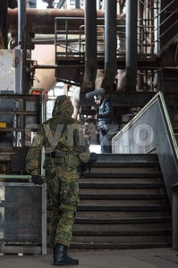 Actor at the filmset in an abandoned industrial building Stock Photo