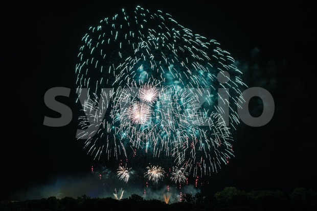 Huge Turquoise Fireworks Stock Photo