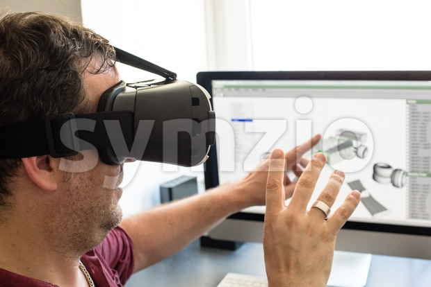 Male engineer with VR glasses Stock Photo
