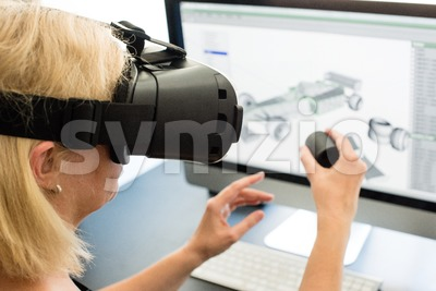 Female engineer with VR glasses Stock Photo