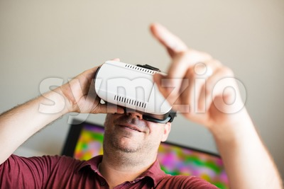 Man wearing VR glasses Stock Photo