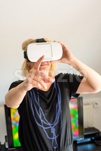 Woman wearing VR glasses Stock Photo