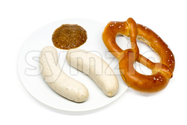 Bavarian white sausages with sweet mustard and pretzel Stock Photo