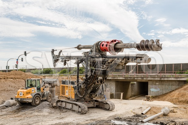 Ostfildern, Germany - September 3, 2016: A large rotary drill and excavator at a construction site of the Stuttgart21 railroad ...